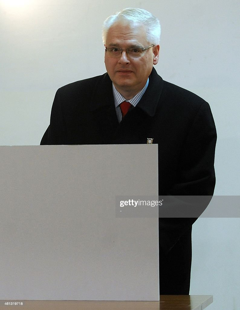 Croatian President <a gi-track='captionPersonalityLinkClicked' href=/galleries/search?phrase=Ivo+Josipovic&family=editorial&specificpeople=6599425 ng-click='$event.stopPropagation()'>Ivo Josipovic</a> fills his ballot at a polling station in Zagreb, on January 11, 2015. Croatians went to the polls to elect a president under the cloud of a deep economic crisis, with incumbent <a gi-track='captionPersonalityLinkClicked' href=/galleries/search?phrase=Ivo+Josipovic&family=editorial&specificpeople=6599425 ng-click='$event.stopPropagation()'>Ivo Josipovic</a> seen as the frontrunner as he sought a second term leading the EU's newest member state.
