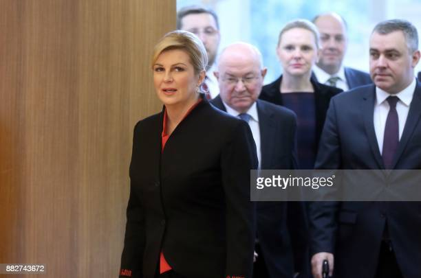 Croatian President Kolinda GrabarKitarovic and her advisors arrive to address a press conference in Zagreb on November 30 a day after the suicide of...