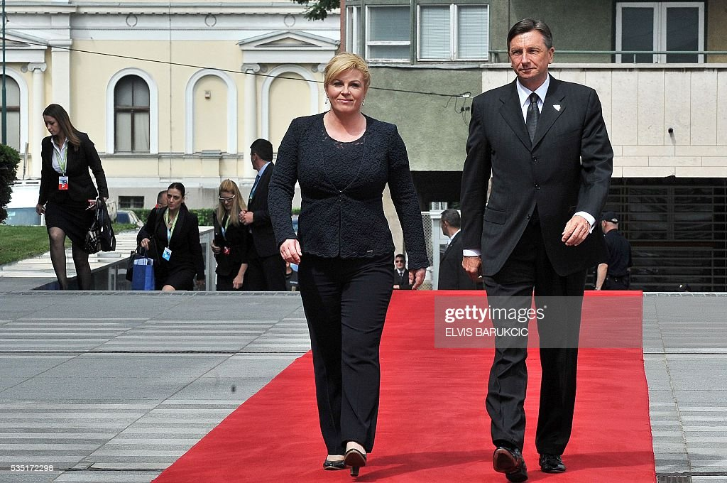 Croatian President Kolinda Grabar-Kitarovic and President of Slovenia Borut Pahor arrive at Bosnia and Herzegovina's National Assembly, during a welcoming ceremony in Sarajevo, on May 29, 2016. Heads of western Balkan nations meet for an annual summit during which they will discuss regional cooperation. / AFP / ELVIS