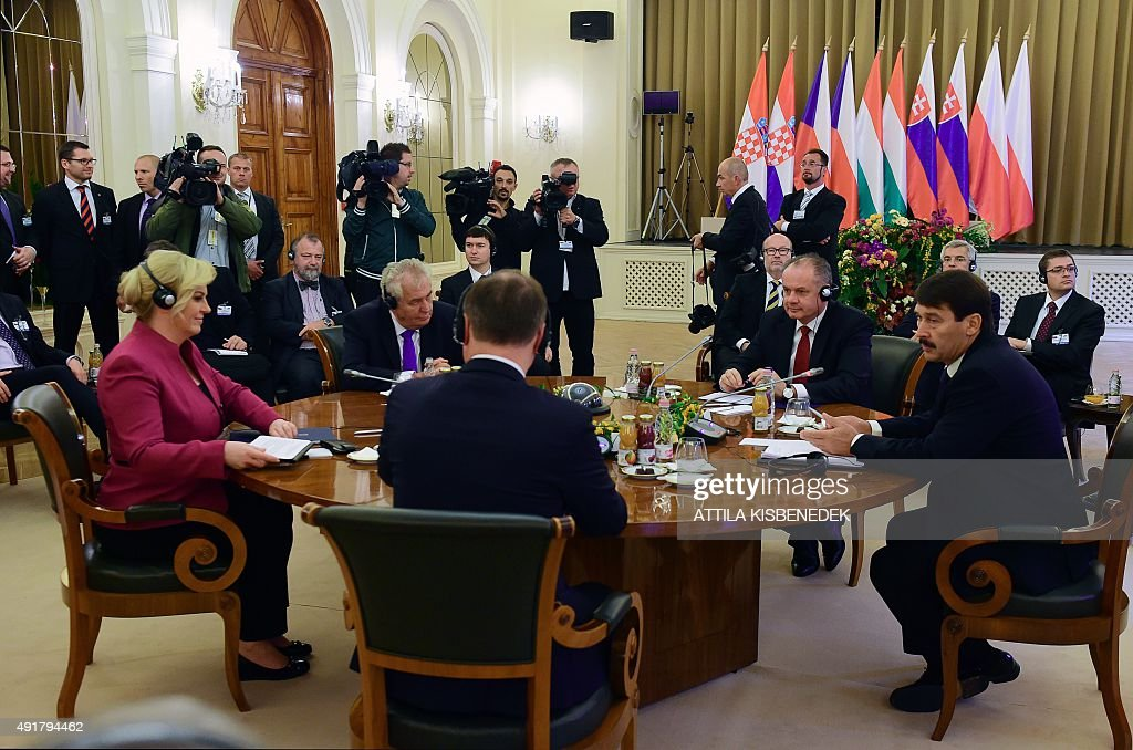 Croatian President Kolinda Grabar-Kitarovic (L) and Presidents of the Visegrad countries (V4) Milos Zeman (2nd L) of the Czech Republic, Andrej Kiska (2nd R) of Slovakia and Janos Ader (R) of Hungary discuss at the ball hall of the Anna Grand Hotel in Balatonfured on October 8, 2015 during their official meeting. The Polish President Andrzej Duda is expected to join the group later in the day.