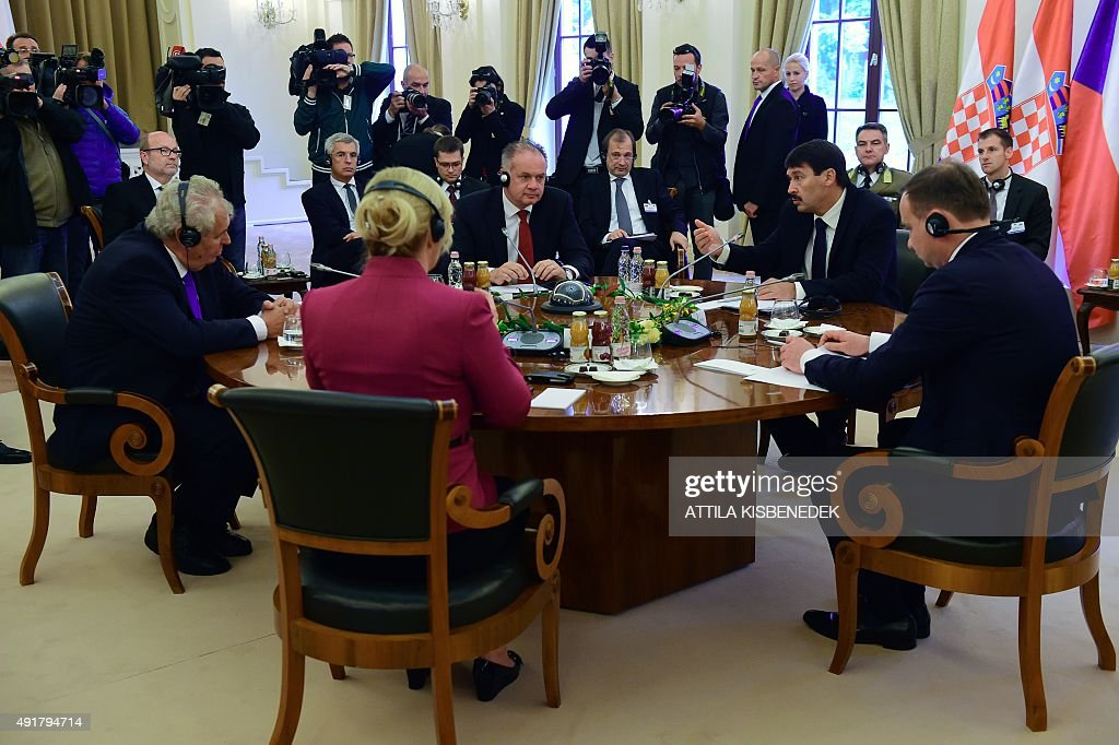 Croatian President Kolinda Grabar-Kitarovic (2nd L) and Presidents of the Visegrad countries (V4) Milos Zeman (L) of the Czech Republic, Andrej Kiska (C, background) of Slovakia, Janos Ader (2nd R) of Hungary and Andrzej Duda (R) of Poland discuss at the ball hall of the Anna Grand Hotel in Balatonfured on October 8, 2015 during their official meeting.