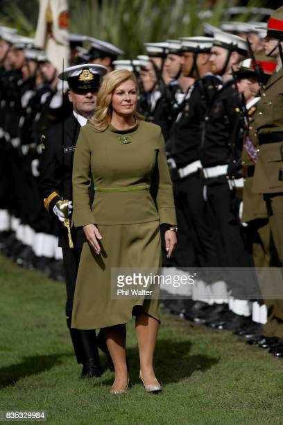 Croatian President Kolinda GrabarKitarovicon inspects a guard of honour at Government House August 19 2017 in Auckland New Zealand President Kolinda...