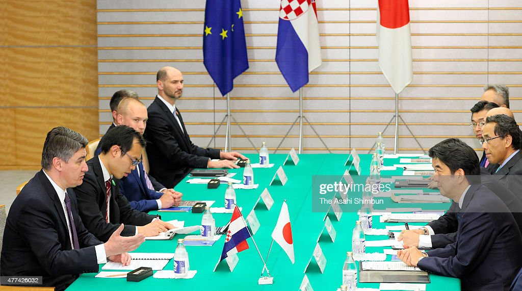 Croatian Prime Minister Zoran Milanovic (1st L) and Japanese Prime Minister Shinzo Abe (1st R) talk during their meeting at Abe's official residence on June 17, 2015 in Tokyo, Japan. Milanovic is the four-day tour in Japan.