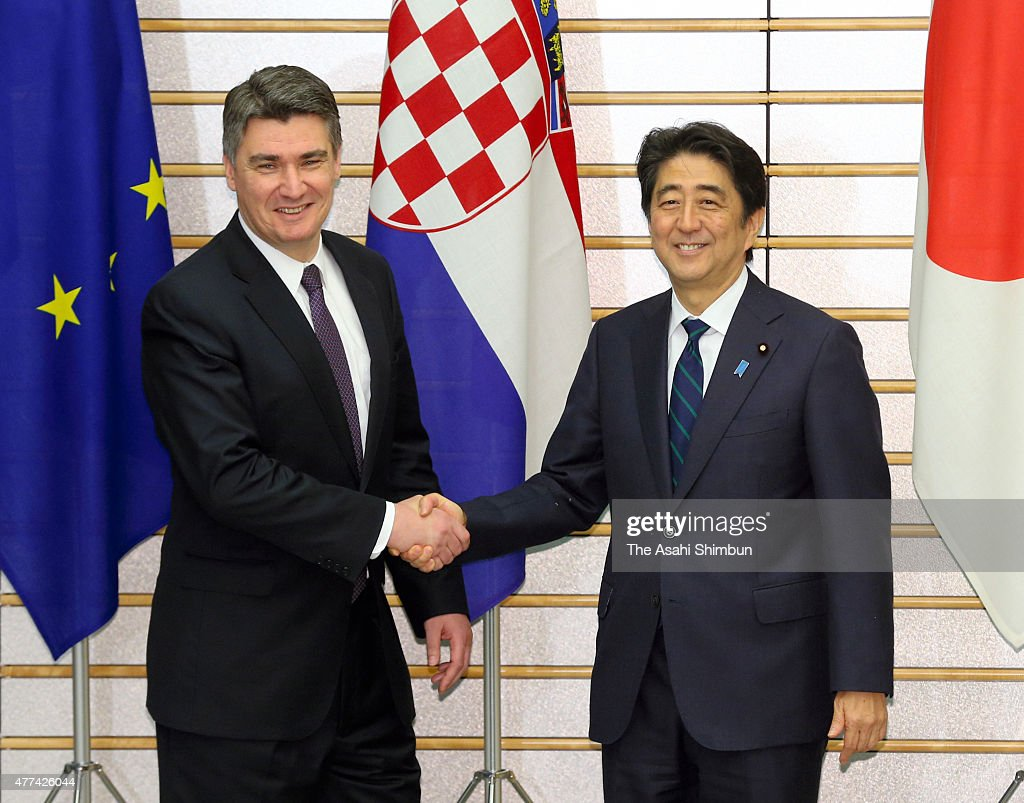 Croatian Prime Minister Zoran Milanovic and Japanese Prime Minister Shinzo Abe shake hand prior to their meeting at Abe's official residence on June 17, 2015 in Tokyo, Japan. Milanovic is the four-day tour in Japan.