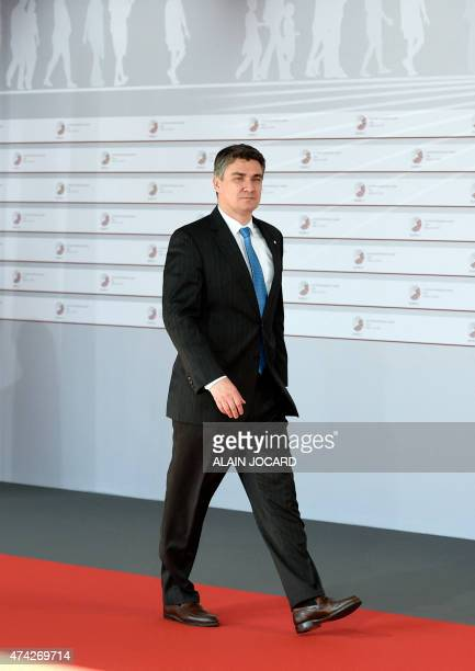 Croatian Prime Minister Zoran Milanovic arrives at the House of the Blackhead for an informal dinner at the start of the fourth European Union...