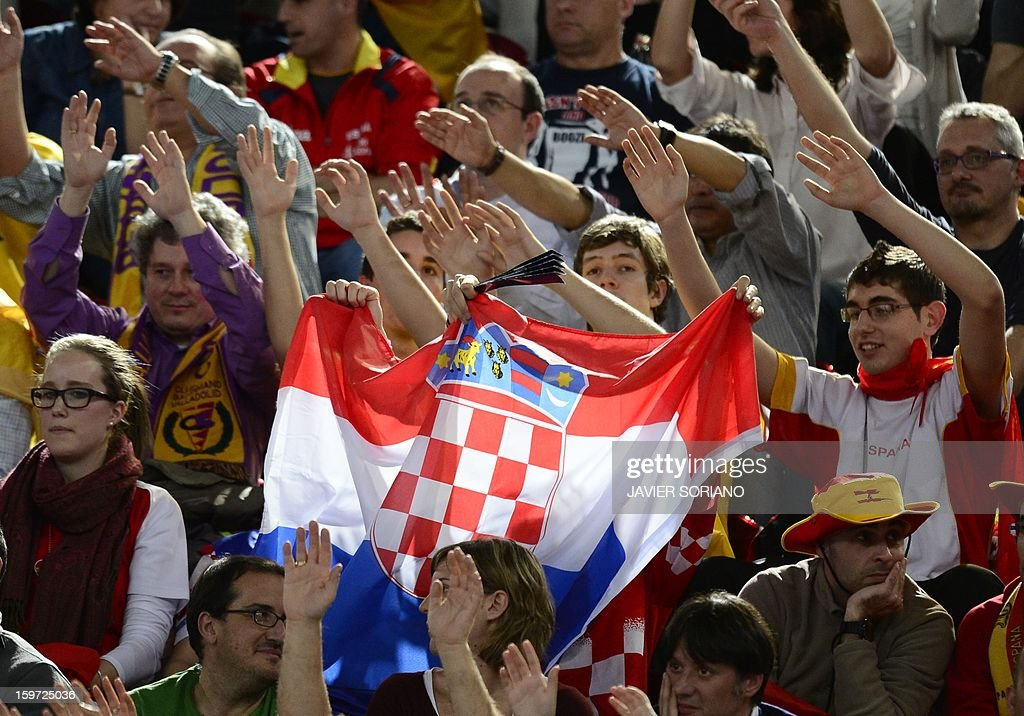 Croatian supporters cheer their team during the 23rd Men's Handball World Championships preliminary round Group D match Spain vs Croatia at the Caja Magica in Madrid on January 19, 2013. AFP PHOTO/ JAVIER SORIANO