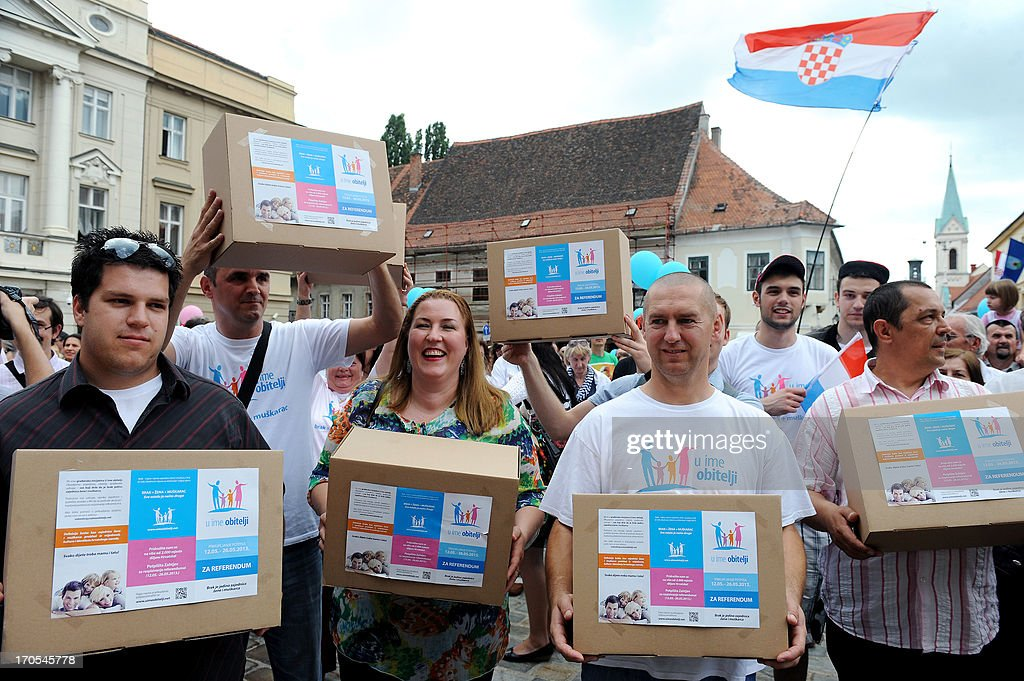 Croatian supporters of a conservative group calling for a referendum to rule out same-sex marriages take part in a march to Croatia's parliament, in Zagreb, on June 14, 2013, to hand over a petition signed by one-fifth of the EU-bound country's electorate. The petition calls for a referendum on whether to introduce a constitutional clause defining marriage as a 'union of a woman and a man'.
