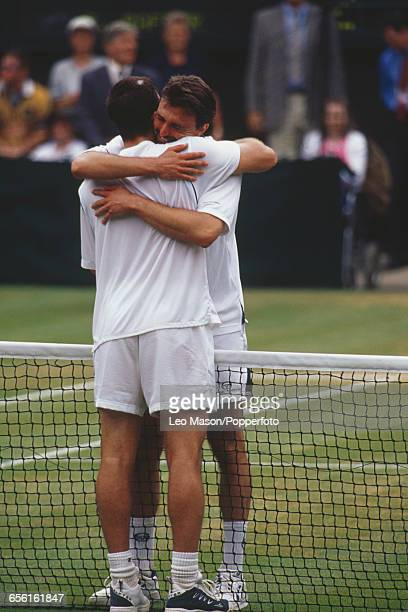 Croatian tennis player Goran Ivanisevic hugs Australian tennis player Pat Rafter after defeating him in the final of the Men's Singles tournament 63...