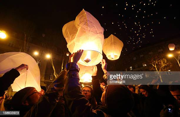 Croatians gather in front of a museum in Zagreb as they participate in an initiative by local artist Kresimir Tadija Kapulic to release into the...