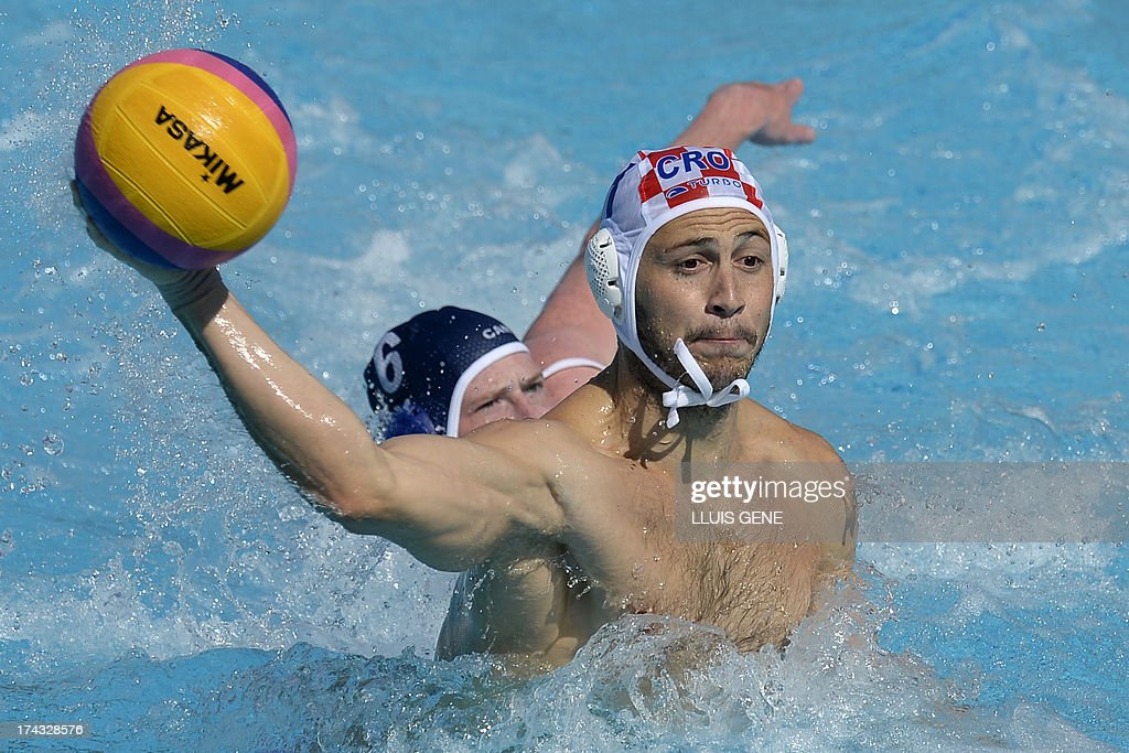 Croatia's Andel Setka (R) vies with Canadian player Luka Bukic (L) during the preliminary round match of the men's water polo competition between Croatia and Canada at the FINA World Championships at the Bernat Picornell swimming pool in Barcelona on July 24, 2013. AFP PHOTO/ LLUIS GENE