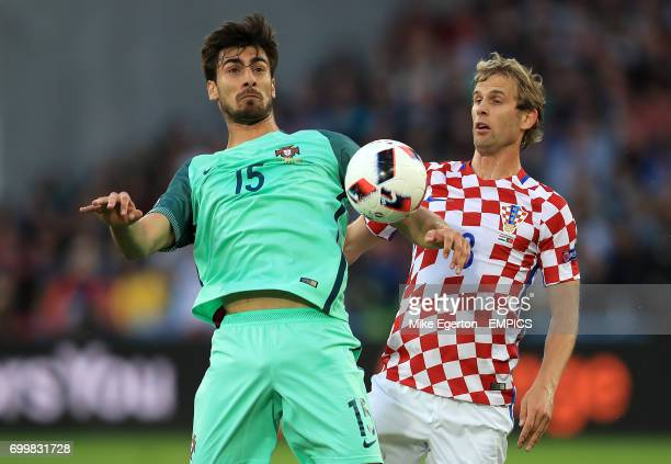 Croatia's Ante Coric and Croatia's Ivan Strinic battle for the ball