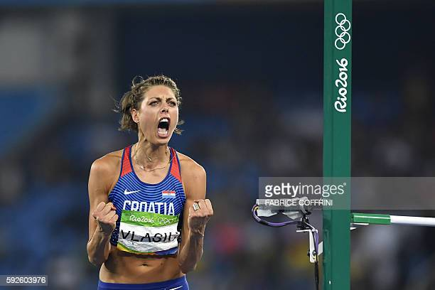 TOPSHOT Croatia's Blanka Vlasic reacts in the Women's High Jump Final during the athletics event at the Rio 2016 Olympic Games at the Olympic Stadium...
