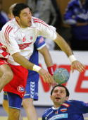 Croatia's Blazenko Lackovic vies with Serbia and Montenegro's Alem Toskic during their game at the main round of the European handball Championships...