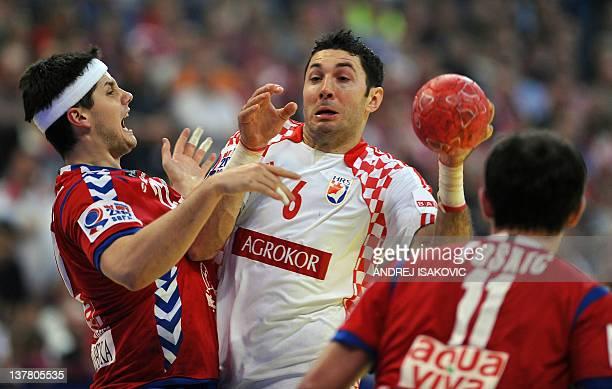 Croatia's Blazenko Lackovic vies with Serbia's Alem Toskic and Serbia's Bojan Beljanski during the men's EHF Euro 2012 Handball Championship...