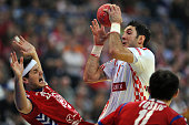 Croatia's Blazenko Lackovic vies with Serbia's Alem Toskic and Serbia's Bojan Beljanski during the men's EHF Euro 2012 Handball Championship...