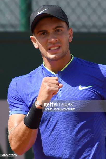 Croatia's Borna Coric reacts after a point against US Steve Johnson during their tennis match at the Roland Garros 2017 French Open on May 31 2017 in...