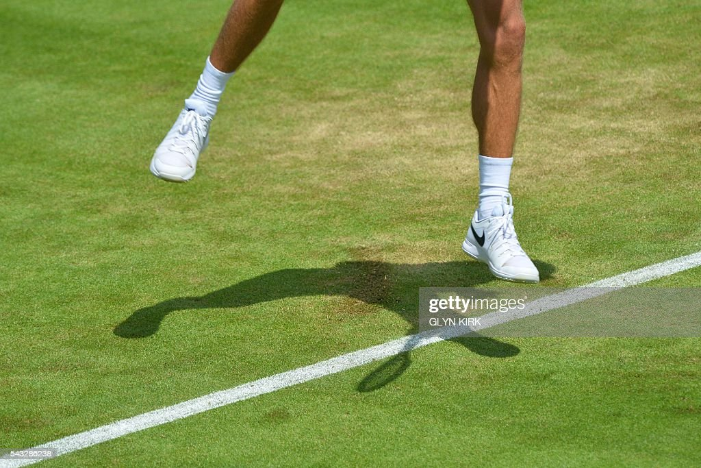 Croatia's Borna Coric serves against Croatia's Ivo Karlovic during their men's singles first round match on the first day of the 2016 Wimbledon Championships at The All England Lawn Tennis Club in Wimbledon, southwest London, on June 27, 2016. / AFP / GLYN