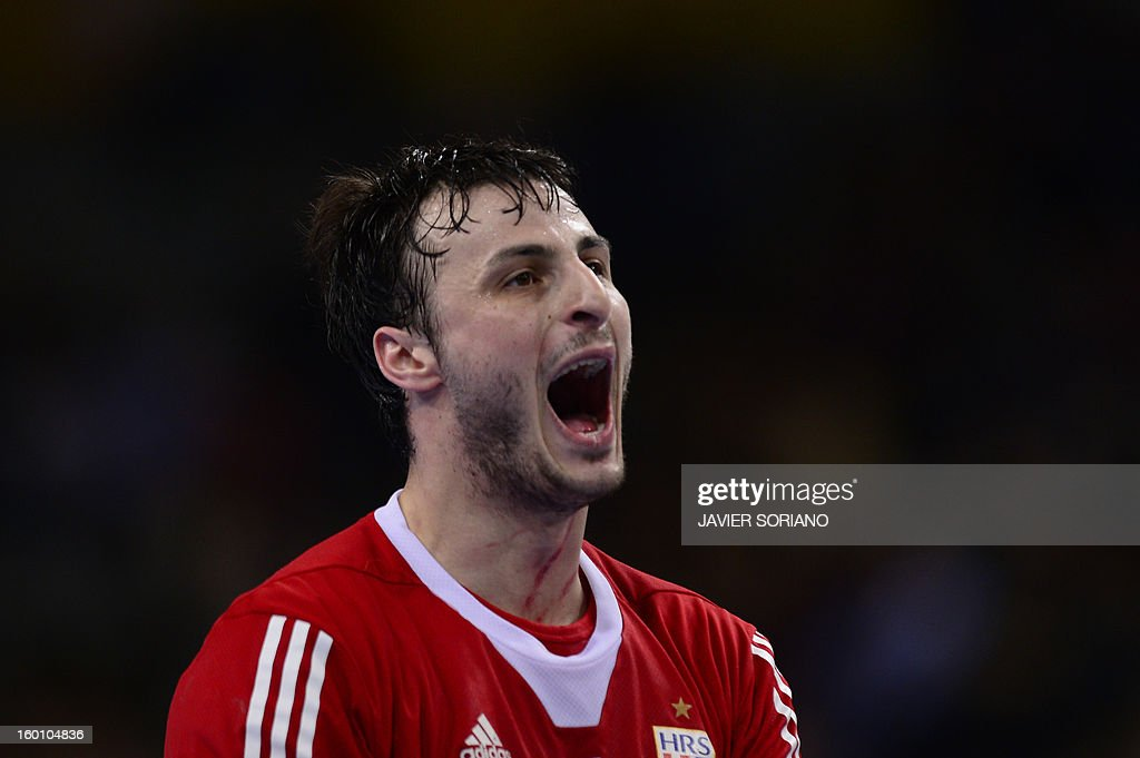 Croatia's centre back Domagoj Duvnjak celebrates after scoring during the 23rd Men's Handball World Championships bronze medal match Slovenia vs Croatia at the Palau Sant Jordi in Barcelona on January 26, 2013.