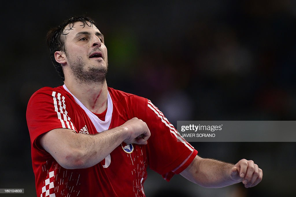 Croatia's centre back Domagoj Duvnjak gestures as he celebrates after scoring during the 23rd Men's Handball World Championships bronze medal match Slovenia vs Croatia at the Palau Sant Jordi in Barcelona on January 26, 2013.