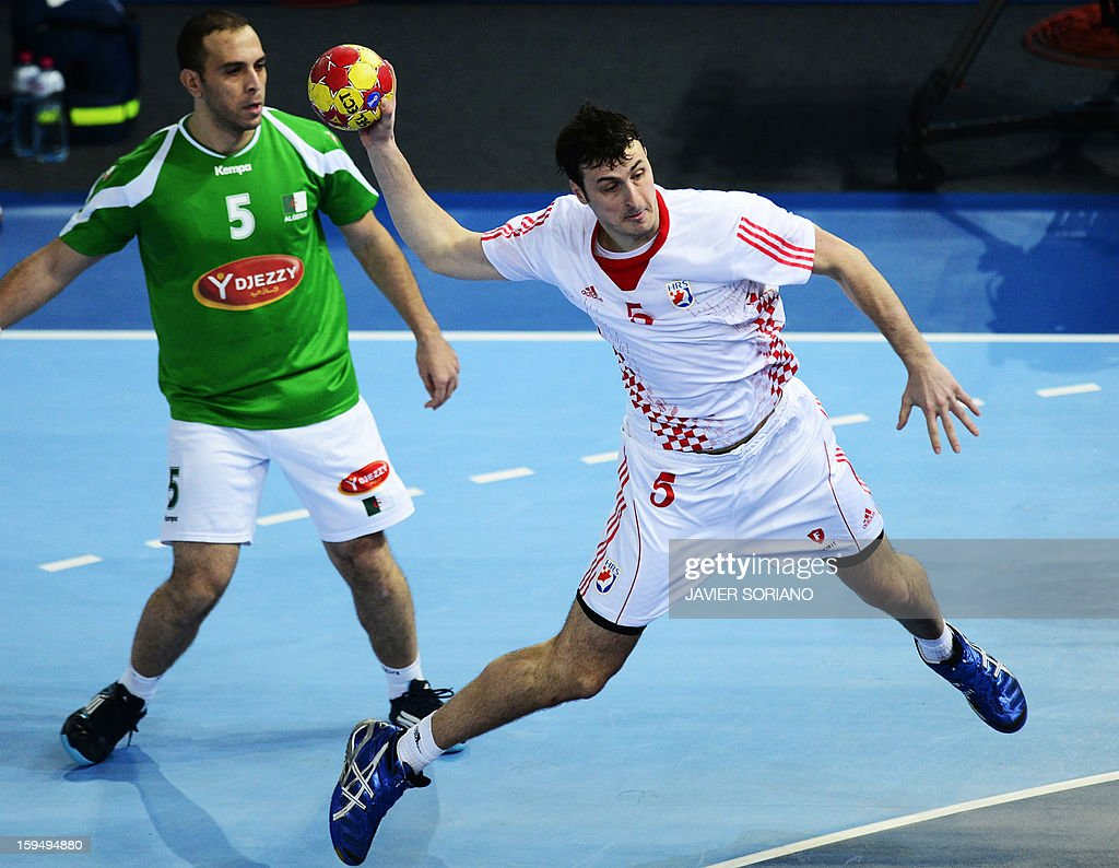 Croatia's centre back Domagoj Duvnjak (R) shoots past Algeria's left back Salah Eddine Cheikh during the 23rd Men's Handball World Championships preliminary round Group D match Algeria vs Croatia at the Caja Magica in Madrid on January 14, 2013.