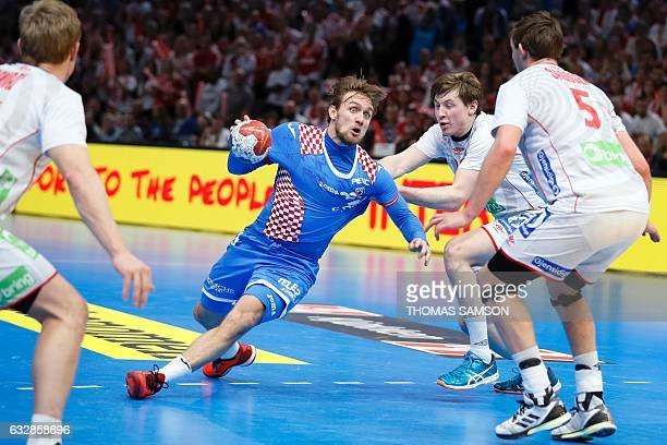 Croatia's centre back Luka Cindric works around Norway's centre back Goran Johannessen and Norway's centre back Sander Sagosen during the 25th IHF...