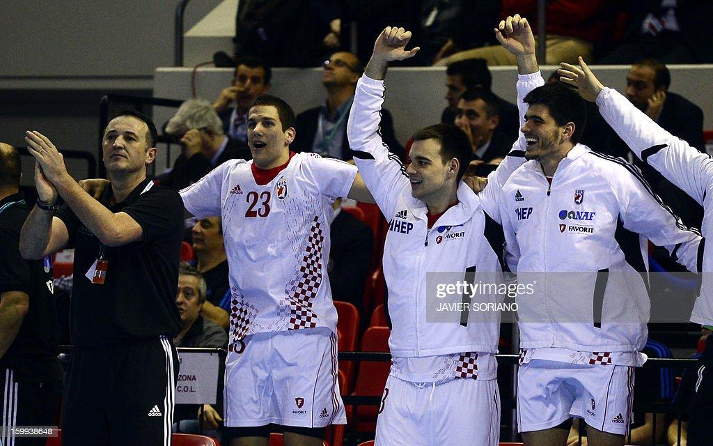 Croatia's coach Slavko Goluza and his players react during the 23rd Men's Handball World Championships quarterfinal match France vs Croatia at the...