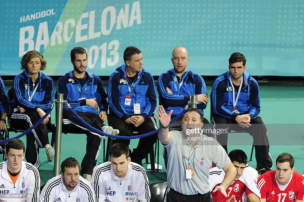 Croatia's coach Slavko Goluza (BottomR) reacts during the 23rd Men's Handball World Championships bronze medal match Slovenia vs Croatia at the Palau Sant Jordi in Barcelona on January 26, 2013. AFP PHOTO/ JOSEP LAGO