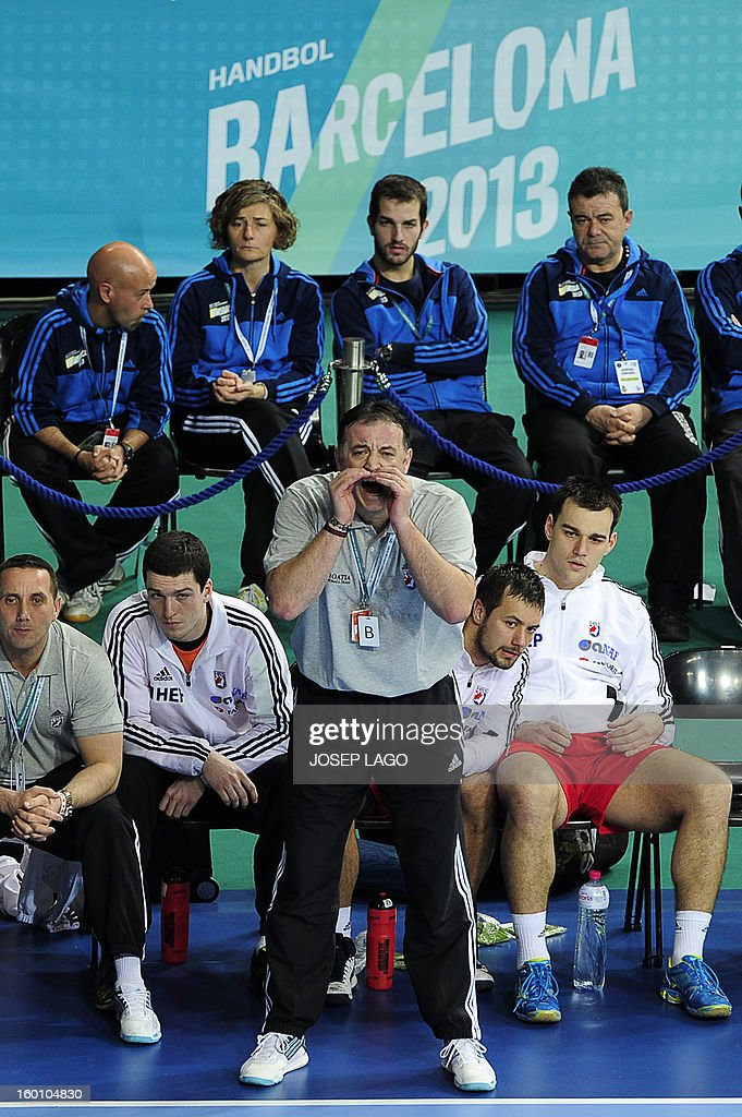 Croatia's coach Slavko Goluza (BottomC) reacts during the 23rd Men's Handball World Championships bronze medal match Slovenia vs Croatia at the Palau Sant Jordi in Barcelona on January 26, 2013.