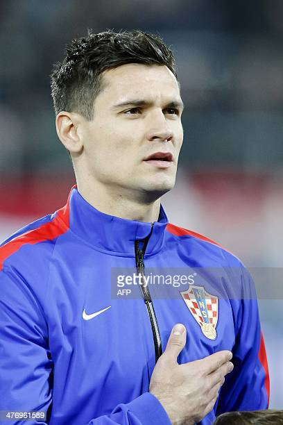 Croatia's defender Dejan Lovren sings the national anthem before the start of the 2014 World Cup international friendly football match between...