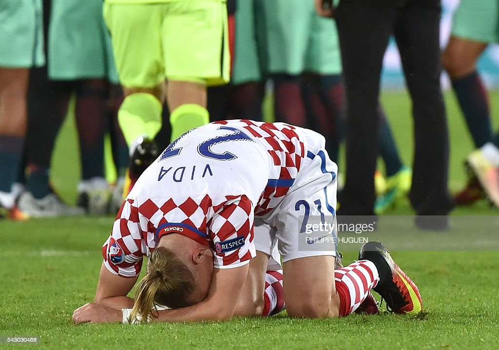 TOPSHOT - Croatia's defender Domagoj Vida bends on the pitch at the end of the Euro 2016 round of sixteen football match Croatia vs Portugal, on June 25, 2016 at the Bollaert-Delelis stadium in Lens. / AFP / PHILIPPE