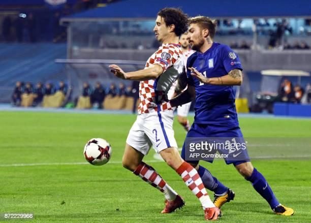 Croatia's defender Sime Vrsaljko vies with Greece's forward Kostas Stafylidis during the WC 2018 playoff football qualification match between Croatia...