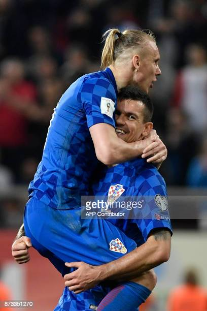 Croatia's Domagoj Vida celebrates with teammate after winning the World Cup 2018 playoff football match Greece vs Croatia on November 12 2017 in...