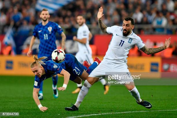 Croatia's Domagoj Vida vies with Greece's Konstantinos Mitroglou during the World Cup 2018 playoff football match Greece vs Croatia on November 12...
