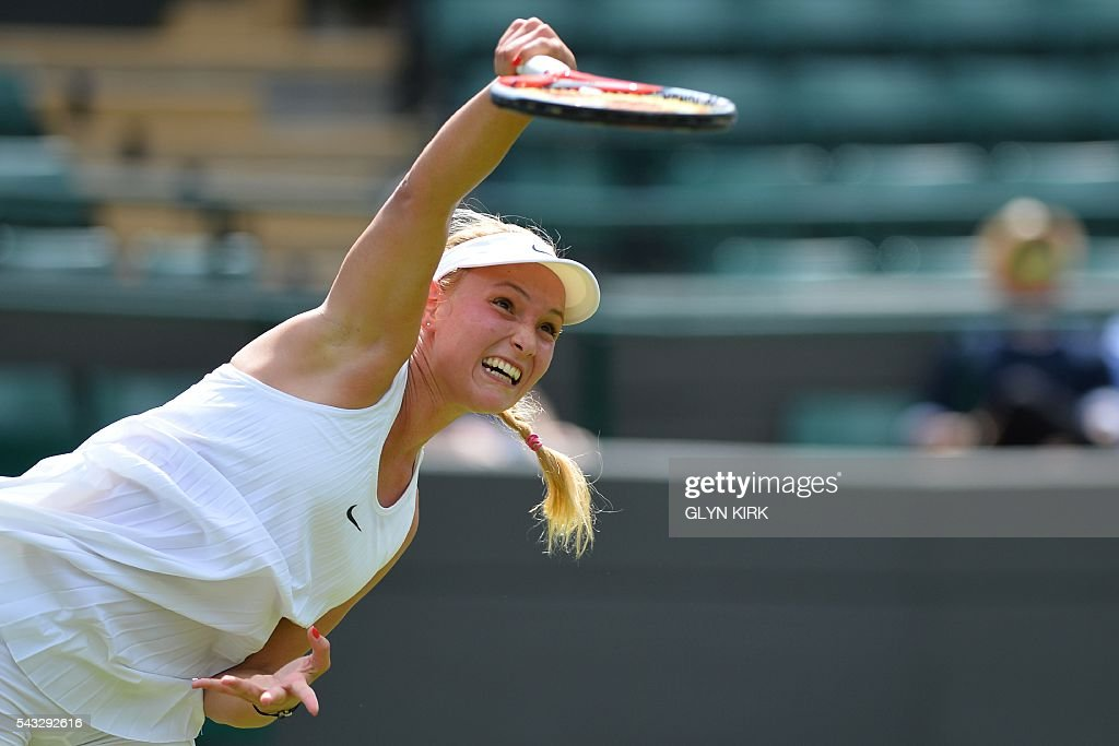Croatia's Donna Vekic serves against US player Venus Williams during their women's singles first round match on the first day of the 2016 Wimbledon Championships at The All England Lawn Tennis Club in Wimbledon, southwest London, on June 27, 2016. / AFP / GLYN
