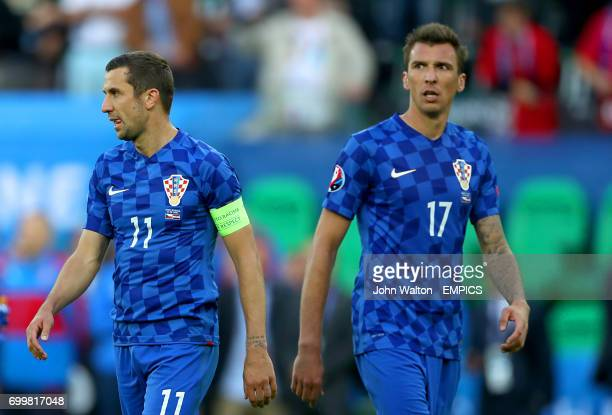 Croatia's Duje Cop and Croatia's Mario Mandzukic look dejected after the final whistle
