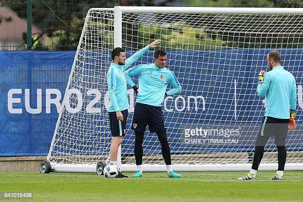 Croatia's goalkeepers Danijel Subasic Lovre Kalinic and Ivan Vargic attend a training session in Deauville northwestern France on June 18 2016 during...