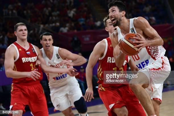 Croatia's guard Leni Roko Ukic vies for the ball with Russia's guard Dmitry Khvostov during the FIBA Eurobasket 2017 men's round 16 basketball match...