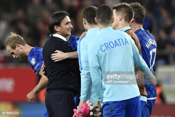 Croatia's head coach Zlatko Dalic celebrates with his team after winning the World Cup 2018 playoff football match between Greece and Croatia on...