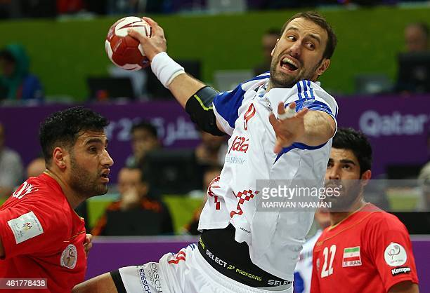 Croatia's Igor Vori attempts a shot on goal during the 24th Men's Handball World Championships preliminary round Group B match between Croatia and...