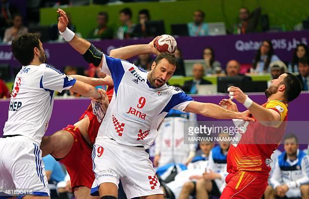 Croatia's Igor Vori defends during the 24th Men's Handball World Championships preliminary round Group B match between Macedonia and Croatia at the...
