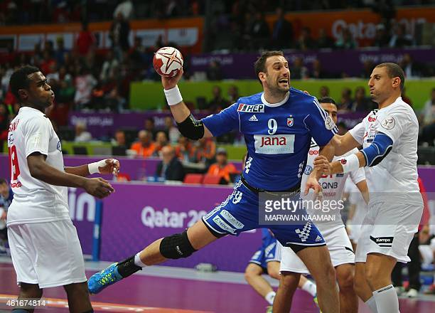Croatia's Igor Vori takes a shot on goal during the 24th Men's Handball World Championships preliminary round Group B match between Tunisia and...