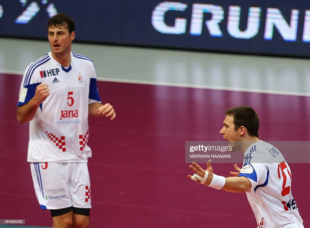 Croatia's Ivan Cupic (R) and Domagoj Duvnjak celebrate during the 24th Men's Handball World Championships preliminary round Group B match Croatia vs Austria at the Duhail Handball Sports Hall in Doha on January 16, 2015. AFP PHOTO / MARWAN NAAMANI