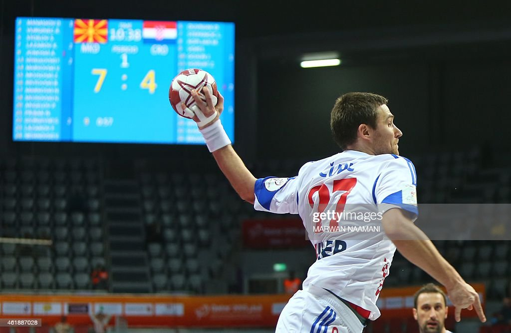 Croatia's Ivan Cupic attempts a shot on goal during the 24th Men's Handball World Championships preliminary round Group B match between Macedonia and Croatia at the Duhail Handball Sports Hall in Doha on January 21, 2015. AFP PHOTO / MARWAN NAAMANI