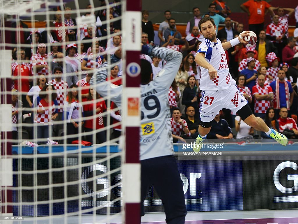 Croatia's Ivan Cupic attempts a shot on goal during the 24th Men's Handball World Championships Eighth Final EF7 match between Croatia and Brazil at the Ali Bin Hamad Al Attiya Arena in Doha on January 25, 2015. AFP PHOTO / MARWAN NAAMANI