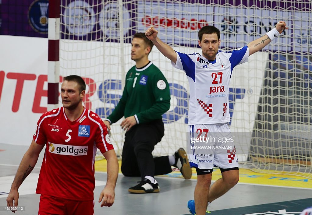 Croatia's Ivan Cupic (R) celebrates a win as Austria's Vytautas Ziura (L) and Thomas Bauer look on during the 24th Men's Handball World Championships preliminary round Group B match Croatia vs Austria at the Duhail Handball Sports Hall in Doha on January 16, 2015.