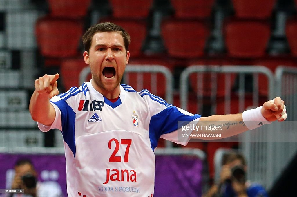 Croatia's Ivan Cupic celebrates after scoring a goal during the 24th Men's Handball World Championships preliminary round Group B match between Macedonia and Croatia at the Duhail Handball Sports Hall in Doha on January 21, 2015. AFP PHOTO / MARWAN NAAMANI