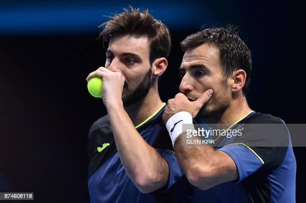 Croatia's Ivan Dodig and BosniaHerzegovina's Marcel Granollers discuss tactics against Britain's Jamie Murray and Brazil's Bruno Soares during their...