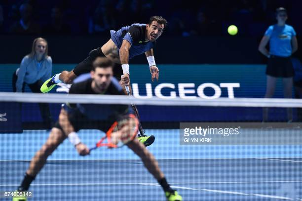 Croatia's Ivan Dodig and BosniaHerzegovina's Marcel Granollers play against Britain's Jamie Murray and Brazil's Bruno Soares during their men's...