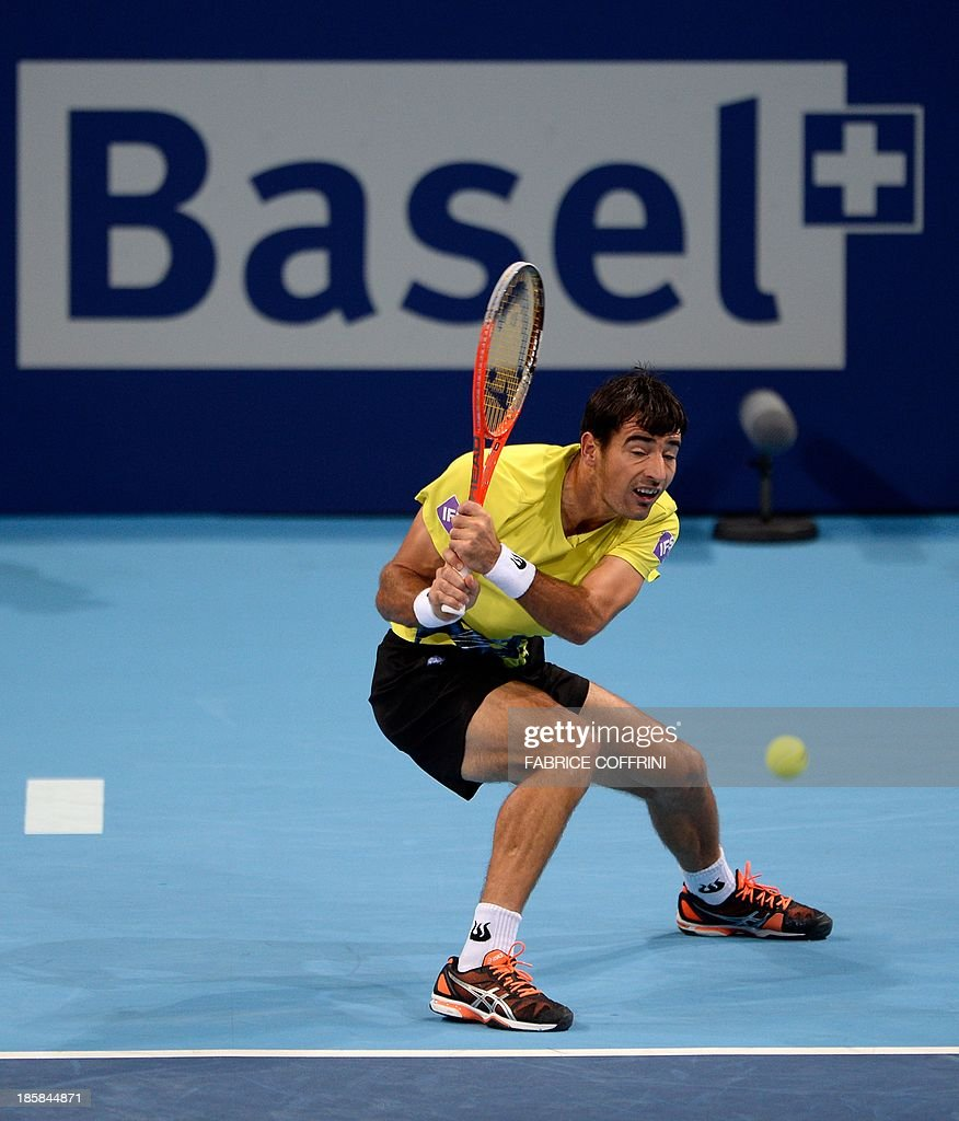 Croatia's Ivan Dodig returns a shot during a quarter final match against Canada's Vasek Pospisil at the Swiss Indoors ATP tennis tournament on October 25, 2013 in Basel.