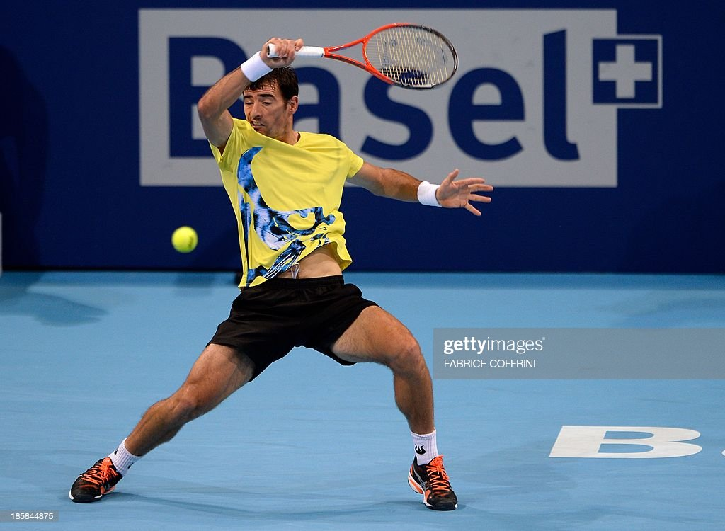 Croatia's Ivan Dodig returns a shot during a quarter final match against Canada's Vasek Pospisil at the Swiss Indoors ATP tennis tournament on October 25, 2013 in Basel. AFP PHOTO / FABRICE COFFRINI